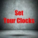 Set Your Clocks concrete wall — Stock Photo