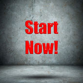 Start Now! concrete wall — Stock Photo