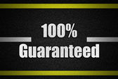 Traffic  road surface with text 100Guaranteed — Stock Photo
