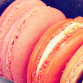 Sweet and colourful french macarons retro-vintage style — Stock Photo