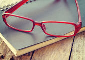 Glasses and book retro-vintage style — Стоковое фото