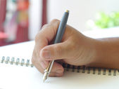 Close up of human hand with pen — Stock Photo