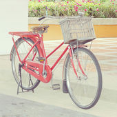 Red bike old retro vintage style — Stock Photo