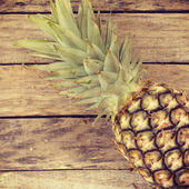pineapple on wood old retro vintage style — Stock Photo