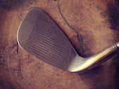 Golf clubs on wood background old retro vintage style — Stock Photo