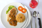 Chicken steak with fried rice and pink wine — Stok fotoğraf