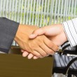 Business handshake on office background — Stock Photo