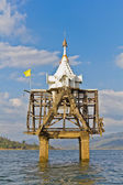Part of ruin of Thai church bell tower expose in the river — Stock Photo