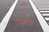 Love lane with red heart mark — Stock Photo