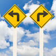 Left turn and right turn road signpost — Stock Photo