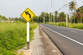 Curved road signpost — Stock Photo