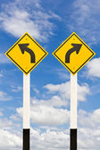 Left and right curved road signpost — Stock Photo