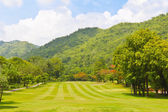 Fairway of a golf course beside the mountain — Stock Photo