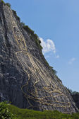 Side view of carved buddha image on the cliff — 图库照片