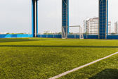 Artificial grass indoor soccer pitch — Stock Photo
