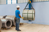 Lifting steel coil — Stock Photo