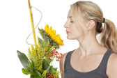 Blond woman with sunflower — Stock Photo