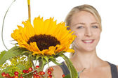 Blond woman with sunflower bouquet — Stock Photo