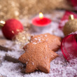Gingerbread star cookies with tealight — Stock Photo
