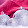 Royalty-Free Stock Photo: Christmas balls with snow and red background