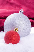 Christmas ball decoration with red background — Stock Photo