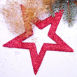 Christmas decoration with red star golden tinsel — Stock Photo