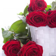 Stock Photo: Red roses in gift basket