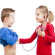 Brother and sister playing a doctor — Stock Photo #17154267