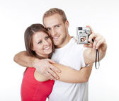 Happy young couple taking pictures — Stock Photo