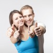 Couple showing thumbs up — Stock Photo