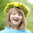 Child with a flower wreath — Stock Photo #25343897