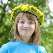 Child with a flower wreath — Stock Photo #25343905