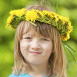 Child with a flower wreath — Stock Photo #25343909