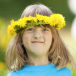 Boy with flower wreath — Stock Photo