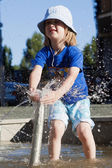 Boy Squirting Water — Stock Photo