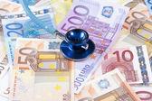 EUROPEAN UNION BANKNOTES AND STETHOSCOPE — Stock Photo