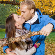 Happy young couple kissing — Foto Stock