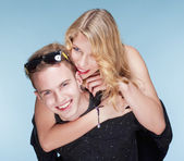 Happy teenage couple piggybacking — Stock Photo