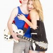 Teenage Couple - Girl Embracing her Boyfriend with Guitar  — Stock Photo