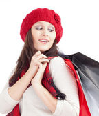 Young Woman in Red Cap with Shopping Bags — ストック写真