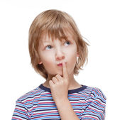 Boy Looking up Thinking, Finger on his Mouth — Stock Photo
