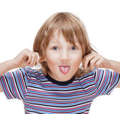 Boy with Blond Hair Sticking out his Tongue — Stock Photo