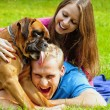 Happy young couple with dog — Stock Photo