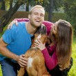 Stock Photo: Happy Young Couple with Dog
