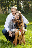 Happy Young Couple with Dog — Photo