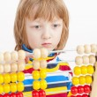 ������, ������: Child Counting on Colorful Wooden Abacus