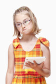 Little Girl with Glasses Holding Tablet — Stock Photo