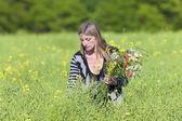 Woman Picking Wild Flowers on the Meadow  — Foto de Stock