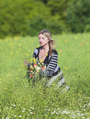 Woman Picking Wild Flowers on the Meadow  — Stockfoto