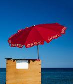 Lifeguard beach umbrella — Stock Photo